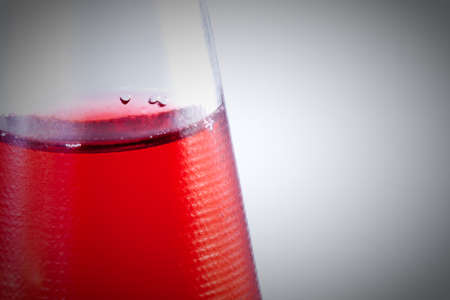 bootle: Red drink in the bootle. Bubbles .