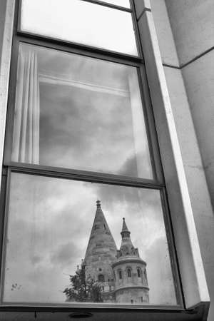 fishermen's: Reflection of Fishermens Bastion in a window hotel in Budapest Stock Photo