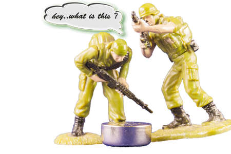 chrome man: Discovery of a battery. Small toy soldiers found a battery Stock Photo