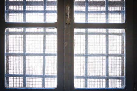 window bars: Freedom beyond the window. Bars in old prison