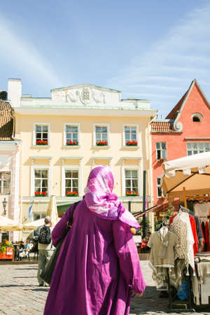 tallin: Purple Muslim. Muslim Woman in City centre in Tallin