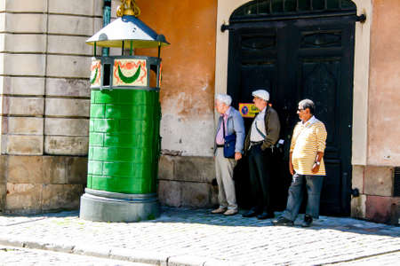 urinal: Stockholm - Sweden: July 2012 - Old men waiting to use a urinal picturesque
