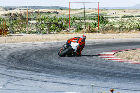 cornering: Curve fast right. Particular of a biker in Running Track.