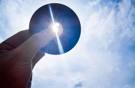 tecnology: Eclipse with an old floppy. Old Tecnology help for Eclipse Stock Photo