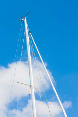 marina life: Sailing Must and Blue Sky, Particular of sailing must in a touristic harbor Stock Photo