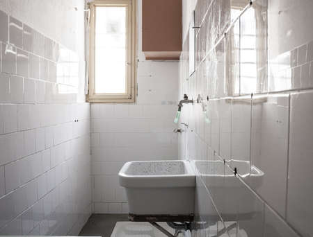 iron barred: bathroom of a cell.  sink and toilet squat. Stock Photo