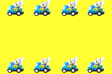 Frame of Toy cars. Concrete mixer Toys Truck. yellow background photo