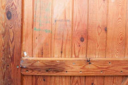 in particular: texture of wooden door. Particular of a wooden door.