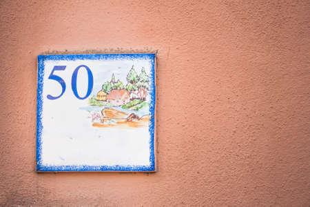 50 number: Street number 50. Particular of artistic street number