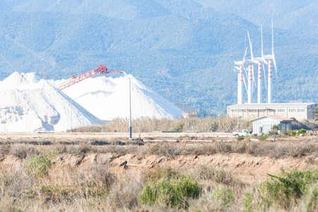 eolic: Energy Eolic salt. Mountain of salt with eolic generator.