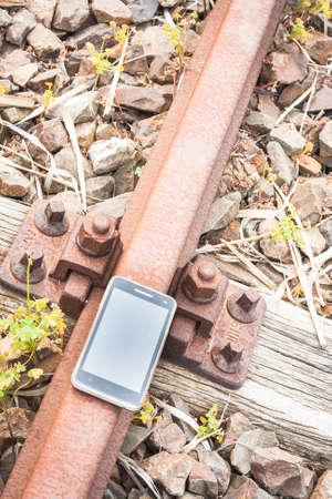 rail travel: Travel on the tracks of the technology. Smartphone on rail like a metaphor.