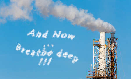 chemically: White smoke in the blue sky with written in cloud text. Stock Photo