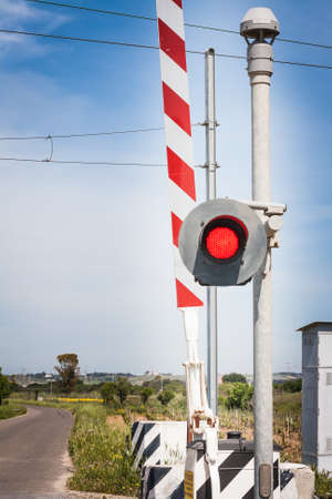 red traffic light crossing level. In front of a red traffic light Imagens