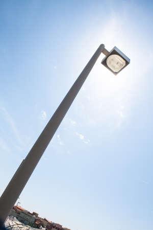 street light alternative energy. Street light that hide the sun. Metaphor of alternative energy and solar energy