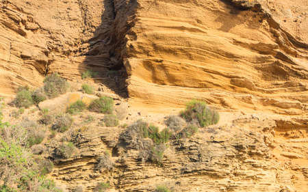 stratification: yellow rock sediments. Stratification of yellow stone Stock Photo