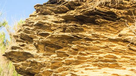 solidify: yellow rock sediments. Stratification of yellow stone Stock Photo
