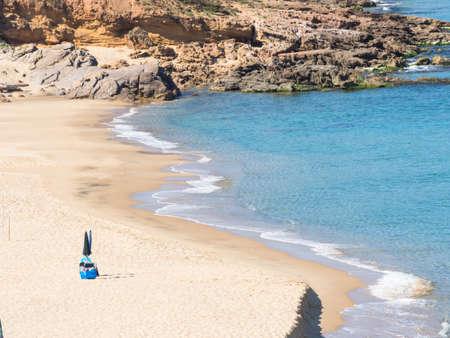arenas: sardinia solitary beach. Lonely beach umbrella in green coast beach in sardinia - Arbus - Is Arenas