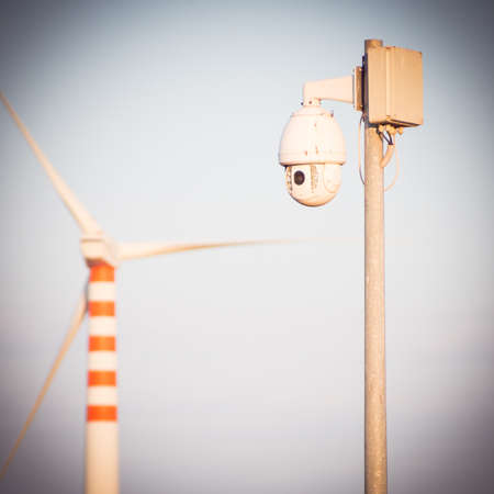 big brother spy: industrial camera control. Camera control near a metal fence in industrial place
