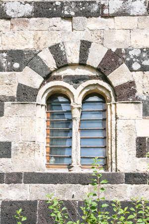 pietro: Particular of window in a church of San Pietro di Sorres Borutta Sassari - Romanesque Church Stock Photo