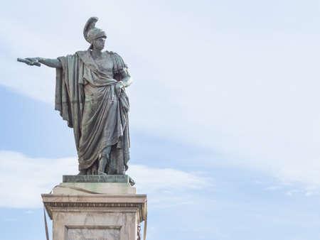 indicate: bronze statue indicate. In front of a bronze staure of Carlo Felice in Cagliari - Sardinia Italy
