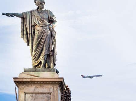 indicate: bronze statue indicate. concept of false, bad, errored data o touristic information Stock Photo