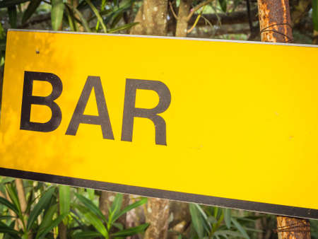 where to eat: Yellow signboard bar. Sign that indicate bar and place where its possible drink and eat.