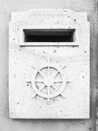 helm: mailbox granite helm. letterbox of stone with helm. Post port.