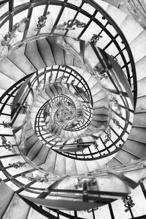 logarithmic: Stairs spiral droste. Particular of spiral stairs with droste effect Stock Photo