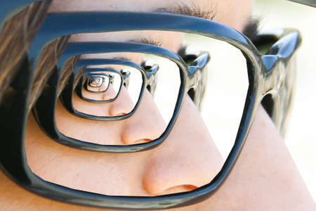 mirrored: Mirror sunglasses  Droste. Look of a girl with sunglasses with droste effect