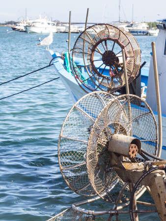 fishermans net: winder fishing net. Particular of fishermans boat .