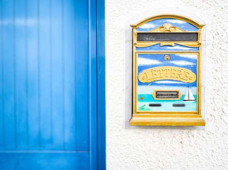 motifs: Letter box decored, Particular of a mailbox decored with marine motifs