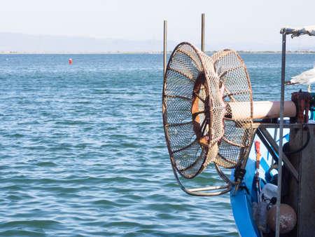 winder: winder fishing net. Particular of fishermans boat .