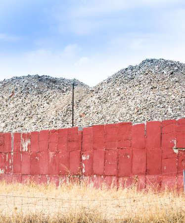 production area: deposit terrain wall. Wall restrainig soil in industrial place