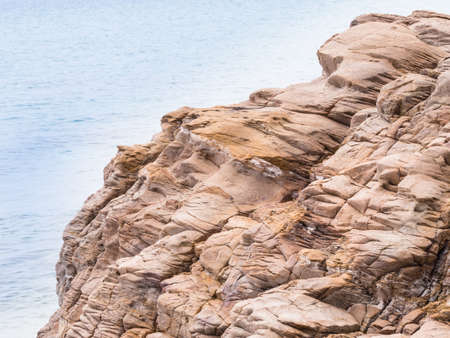 basalt: stone faces basalt. Basaltic stone with faces for erosion of the wind and waves Stock Photo