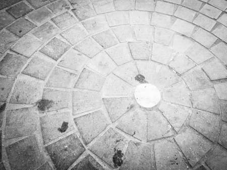 cobblestones: cobblestones in circle. Image of urban pavement dirty
