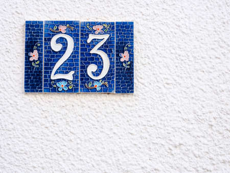 particular: Street number 23. Particular of artistic street number Stock Photo