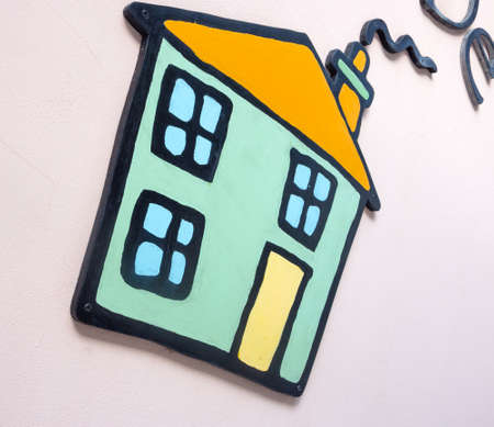 public address: cottage applied on a wall. Small application to the wall of a small house
