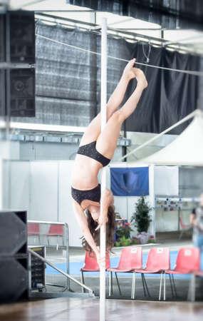 upside: martial arts demonstration. dancer pole dance upside down.