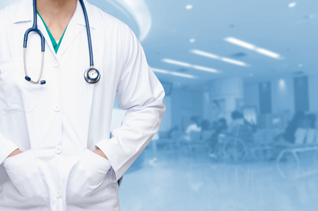 smart doctor with a stethoscope around his neck on the hospital blurred background, healthcare medical technology concept, copy space. Stockfoto