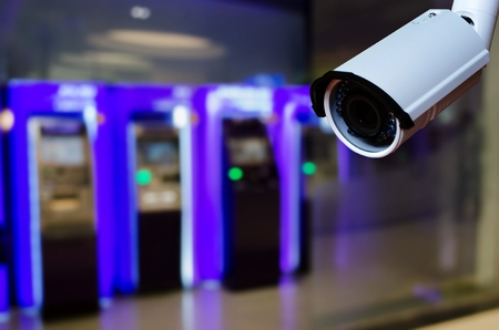 cctv security camera on blurred background of ATM Machine for withdraw or deposit cash money, security technology concept 版權商用圖片