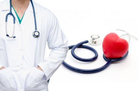smart doctor with a stethoscope around his neck with red heart and a stethoscope on white background health care medical technology concept soft focus selective focus.