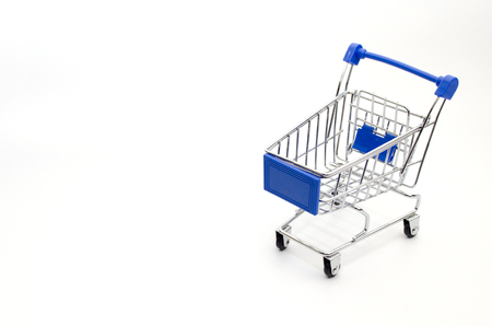 mini supermarket shopping cart blue color on white background, holiday sale and online shopping concept, selective focus, copy space