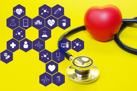 stethoscope and red heart on yellow background with medical icon in hexagon pattern, heart health care, laboratory, science, chemical and medical research concept