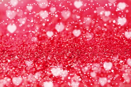 beautiful red or pink glitter texture and heart bokeh light background for holidays, valentine day, christmas and new year festival abstract background, copy space for text or media content
