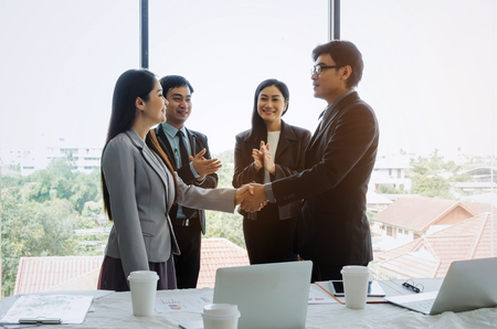 group of business people handshake and clapping hand after finishing up to greeting start up project a business meeting in office, success, meeting, partner, teamwork, community, connection concept 版權商用圖片