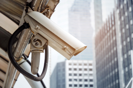 CCTV, security camera system operating in modern city building background, surveillance security, internet network connection, live view, record, video real time and safety technology concept Imagens