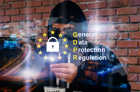 double exposure of man in black hood jacket stealing information with laptop computer and credit card with world map and General Data Protection Regulation (GDPR) diagram, privacy and security concept