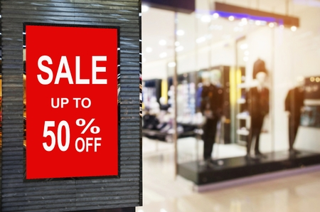 big sale 50% mock up advertise billboard or advertising light box with blurred image of popular fashion clothes shop showcase in department store, commercial, marketing and advertisement concept Stock Photo - 106697850