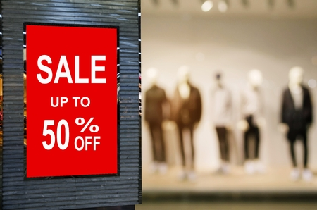 big sale 50% mock up advertise billboard or advertising light box with blurred image of popular fashion clothes shop showcase in department store, commercial, marketing and advertisement concept Stock Photo