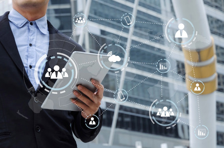 young handsome business man reading information about finance news with mobile tablet with virtual innovation, network connection interface diagram, investment, technology and internet concept Stock Photo